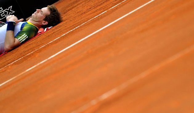 Andy Murray lies on the court as he receives treatment during the ATP Rome Open tennis tournament on May 15, 2013