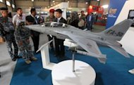 A FA-50 fighter jet model is displayed at Baghdad's International Fair for Defence and Security on April 15, 2012. The Philippines will buy 12 South Korean FA-50 fighter jets to strengthen its poorly-armed military, government spokesmen said Wednesday, amid increasing maritime tensions with China