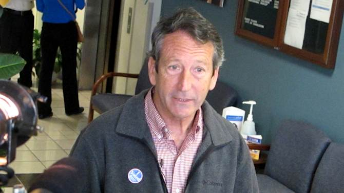 Former South Carolina Gov. Mark Sanford speaks with reporters on Tuesday, March 19, 2013, at a polling place in Charleston, S.C. Sanford, trying to make a political comeback, is one of 16 Republicans running Tuesday in the GOP primary in a special election to fill South Carolina's vacant 1st Congressional District seat.   (AP Photo/Bruce Smith).