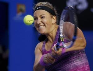 Victoria Azarenka of Belarus plays a shot during her women's singles match against Yvonne Meusburger of Austria at the Australian Open 2014 tennis tournament in Melbourne