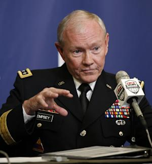 "FILE - This Aug. 20, 2014 file photo shows Joint Chiefs Chairman Gen. Martin Dempsey speaking in New York. President Barack Obama's military leadership made clear in recent days that the threat from the Islamic State militants, who murdered American journalist James Foley, cannot be fully eliminated without going after the group in Syria, as well as Iraq.""This is an organization that has an apocalyptic, end-of-days strategic vision and which will eventually have to be defeated,"" said Dempsey. ""Can they be defeated without addressing that part of their organization which resides in Syria? The answer is no. That will have to be addressed on both sides of what is essentially at this point a nonexistent border."" (AP Photo/Kathy Willens, File)"