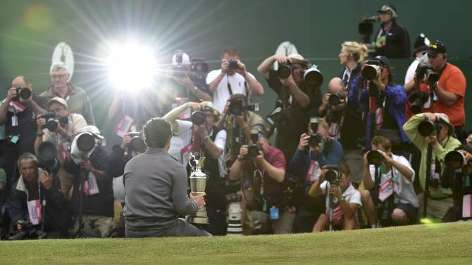 Rory McIlroy of Northern Ireland poses as he holds the Claret Jug after winning the British Open Championship at the Royal Liverpool Golf Club in Hoylake