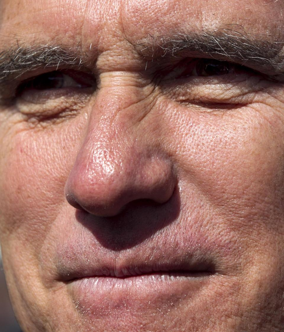 Republican presidential candidate, former Massachusetts Gov. Mitt Romney listens while greeting people in the audience at a campaign event in Tunkhannock, Pa.., Thursday, April 5, 2012. (AP Photo/Steven Senne)