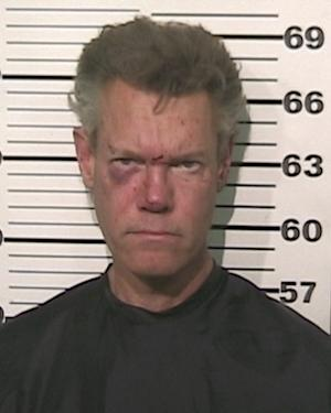 FILE - This file photo provided by the Grayson County, Texas, Sheriff's Office shows Country singer Randy Travis. A prosecutor says the country music star is expected to enter a guilty plea in a drunken-driving case in North Texas. (AP Photo/Grayson County Sheriff's Office)
