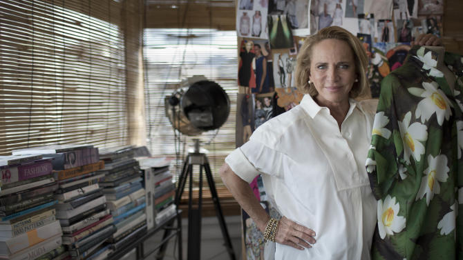 In this Feb. 26, 2013 photo, Brazilian designer Lenny Niemeyer poses for a photo in her office in Rio de Janeiro, Brazil. Before she became Brazil's bikini queen, with an empire of chic boutiques and legions of VIP fans, Niemeyer was locked away in her garage, making swimwear from scraps of used cloth and sliced cow bones. Known for her use of muted earth tones and the clean, almost architectural lines of her swimwear, Niemeyer sells some 350,000 pieces a year, mostly at her 26 boutiques throughout the country, but also at multi-mark shops in Britain, France, the Bahamas and in 23 U.S. states. (AP Photo/Felipe Dana)