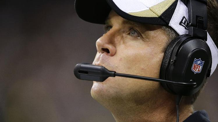 New Orleans Saints head coach Sean Payton watches from the sideline in the second half of an NFL football game against the Carolina Panthers in New Orleans, Sunday, Dec. 8, 2013