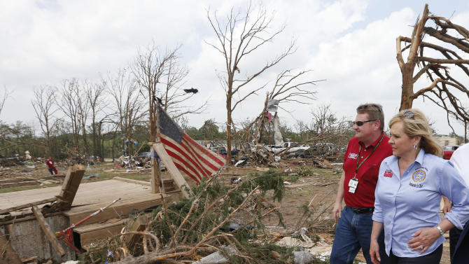 Oklahoma Gov. Mary Fallin, right, walks through the Steelman Estates Mobile Home Park, which was hard hit in Sunday's tornado, with Albert Ashwood, left, Director of the Oklahoma Department of Emergency Management, near Shawnee, Okla., Monday, May 20, 2013. (AP Photo Sue Ogrocki)