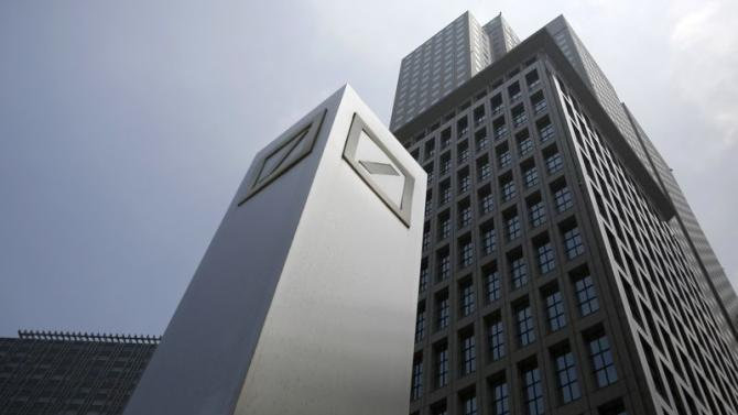 Logos of Deutsche Bank AG are seen in Tokyo