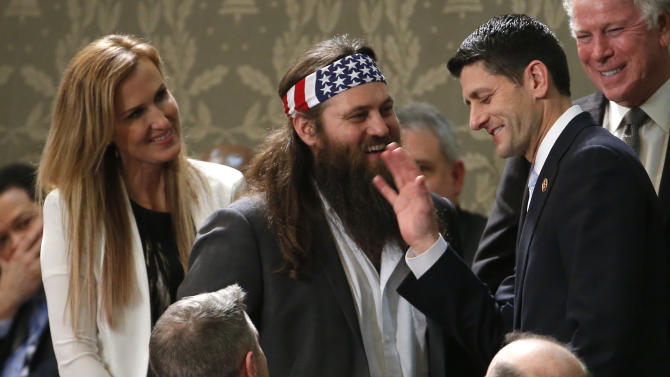 Duck Dynasty's Willie Robertson, center and his wife Korie, talk with Rep. Paul Ryan, R-Wis., before President Barack Obama's State of the Union address on Capitol Hill in Washington, Tuesday Jan. 28, 2014. (AP Photo/Charles Dharapak)