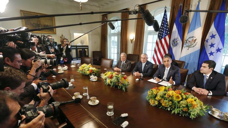U.S. President Obama speaks while he hosts a meeting with El Salvador's President Sanchez Ceren, Guatemala's President Perez Molina and Honduras' President Orlando Hernandez in the Cabinet Room of the White House in Washington
