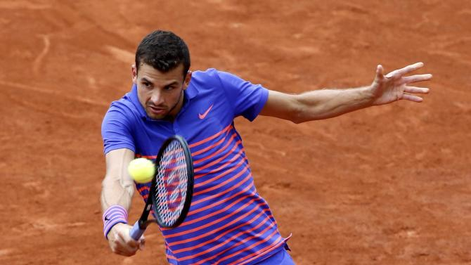 Grigor Dimitrov of Bulgaria plays a shot to Jack Sock of the U.S. during their men's singles match at the French Open tennis tournament at the Roland Garros stadium in Paris