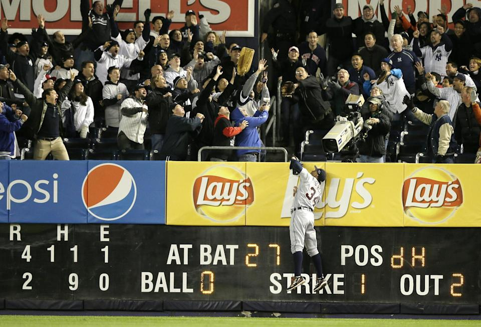 Detroit Tigers' Avisail Garcia tries to catch the home run of New York Yankees' Raul Ibanez in the ninth inning of Game 1 of the American League championship series Saturday, Oct. 13, 2012, in New York. (AP Photo/Matt Slocum)