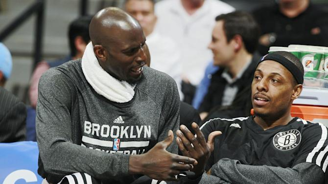 Brooklyn Nets forwards Kevin Garnett, left, and Paul Pierce confer while on the bench as the Nets face the Denver Nuggets in the third quarter of the Nets' 112-89 victory in an NBA basketball game in Denver on Thursday, Feb. 27, 2014