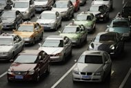Cars line up as they stop at traffic lights on a street in Shanghai on January 9. Vehicle sales in China rose 16 percent year-on-year in May to 1.61 million units, indicating a strengthening recovery in the world's biggest auto market