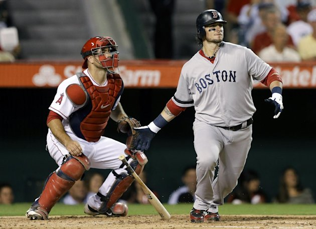 Boston Red Sox's Jarrod Saltalamacchia, right, watches his RBI-single against the Los Angeles Angels during fourth inning of a baseball in Anaheim, Calif., Tuesday, Aug. 28, 2012. (AP Photo/Chris Carl