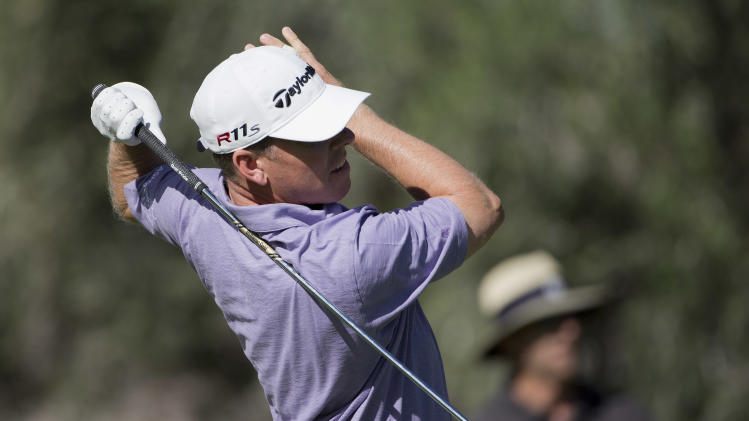 Justin Leonard follows through on his tee shot off the eighth hole during the Justin Timberlake Shriners Hospitals for Children Open golf tournament on Thursday, Oct. 4, 2012, in Las Vegas. (AP Photo/Julie Jacobson)