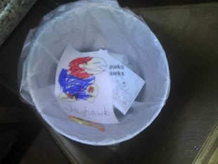 Emma Burton's reluctant Jayhawk coloring in the family trash can  Lost Lettermen via Bug Bytes