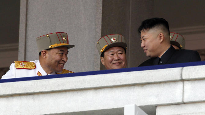 """FILE - In this April 15, 2012 file photo, North Korean leader Kim Jong Un, right, chats with North Korean People's Army senior officers, Vice Marshal and the military's General Staff Chief Ri Yong Ho, left, and Vice Marshal and Vice Chairman of the Central Military Commission Choe Ryong Hae, during a mass military parade in Kim Il Sung Square to celebrate the centenary of the birth of his grandfather, national founder Kim Il Sung in Pyongyang, North Korea. The July 16 announcement that Ri, the country's most powerful military official, had been dismissed due to """"illness"""", set off a predictable wildfire of speculation and rumors south of the border. (AP Photo/Ng Han Guan, File)"""