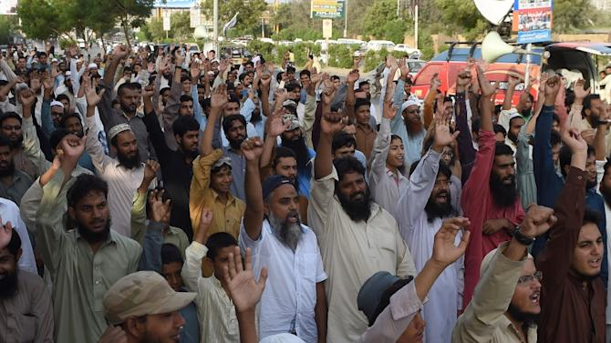 Pakistan members of Jamaat ud Dawa (JuD) shout slogans after the absentia funeral prayer for Afghanistan's deceased Taliban chief Mullah Omar, in Karachi on August 2, 2015