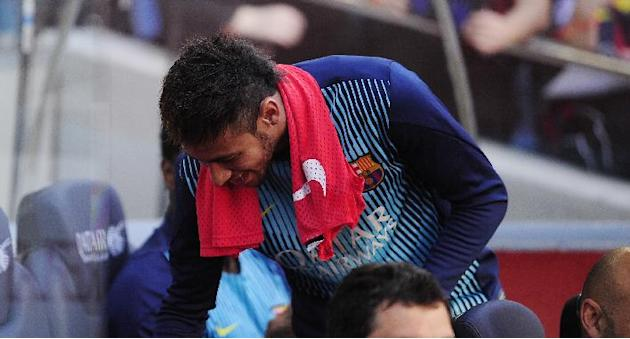 FC Barcelona's Neymar, from Brazil, takes his place on the bench prior to the Spanish La Liga soccer match between FC Barcelona and Osasuna at the Camp Nou stadium in Barcelona, Spain, Sunday, Mar