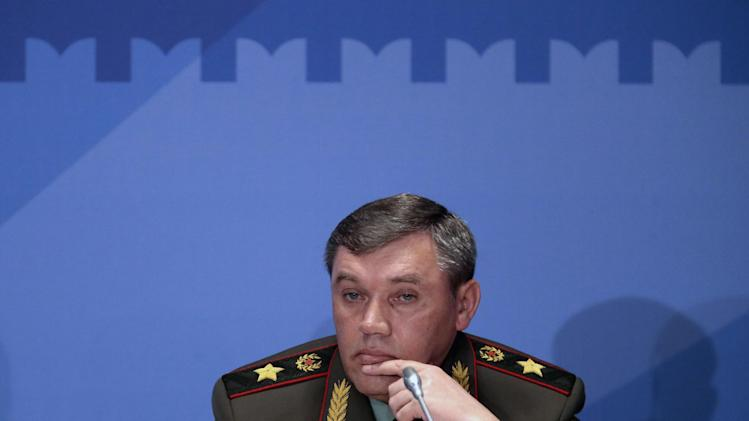 Gen. Valery Gerasimov, the chief of the Russian military's General Staff, listens, during a security conference in Moscow, Russia, Thursday, May 23, 2013. The top Russian military officer has warned the West that Moscow reserves the right to take steps in response to the U.S.-led NATO missile defense plans for Europe if it sees it as a threat.  (AP Photo/Mikhail Metzel)