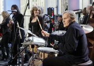 "FILE - In this Oct. 9, 2009 file photo, Levon Helm, right, performs with his band on the ""Imus in the Morning"" program on the Fox Business channel, in New York. At center is his daughter Amy Helm. A message posted Tuesday, April 17, 2012 on the 71-year-old musician's website by his family says ""Levon is in the final stages of his battle with cancer."" Helm was diagnosed with throat cancer in 1998 and the illness reduced his voice to a whisper. But he still continued to sing on albums and at rollicking concerts at his Woodstock home. Helm was a key member of The Band and lent his distinctive Southern voice to classics like ""The Weight"" and ""The Night They Drove Old Dixie Down."" (AP Photo/Richard Drew, file)"