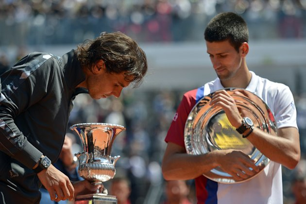 Spanish Rafael Nadal (L) And Serbian Novak Djokovic Celebrate With Their Trophies AFP/Getty Images