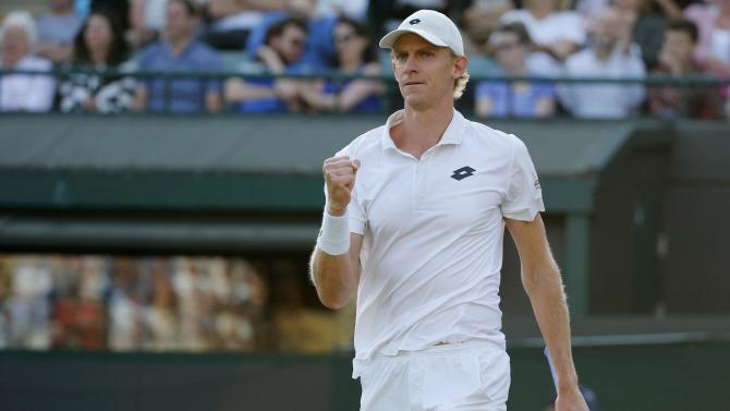 Kevin Anderson of South Africa celebrates after winning the first set of his match against Novak Djokovic of Serbia at the Wimbledon Tennis Championships in London