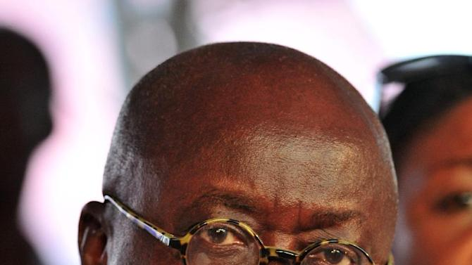 Opposition presidential candidate Nana Akufo-Addo looks on from the stage during his final campaign rally ahead of Friday's presidential election, in Accra, Ghana, Wednesday, Dec. 5, 2012. After five coups and decades of stagnation, the West African nation of 25 million is now a pacesetter for the continent's efforts to become democratic. Ghanaians will go to the polls on Friday to choose between four candidates, including President John Dramani Mahama, a former vice president who assumed the top post in July after the death of president John Atta Mills, and former foreign minister Akufo-Addo who lost the presidency by less than 1 percent in 2008. (AP Photo/Christian Thompson)