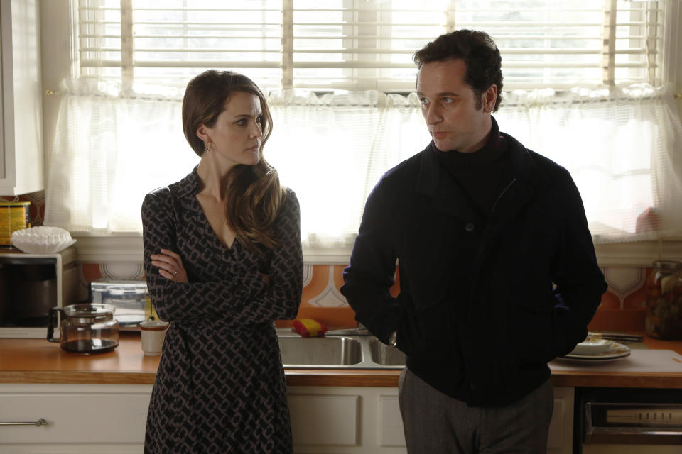 "This TV publicity image released by FX shows Keri Russell as Elizabeth Jennings, left, and Matthew Rhys as Philip Jennings in a scene from the spy drama ""The Americans."" (AP Photo/FX, Craig Blankenhorn)"
