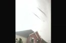 In this image made from video provided by Charles Gafford, a massive tornado passes over his friend Alex Rodriguez's neighborhood in Moore, Okla. on Monday, May 20, 2013. The 19-year-old men took cover in Rodriguez's cellar during the deadly tornado and used their cellphones to get video of the twister as it passed over the home. (AP Photo/Charles Gafford & Alex Rodriguez)