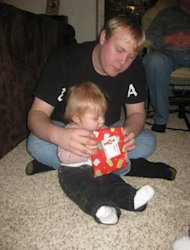My husband and son opening a Christmas gift.