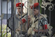 "Egyptian soldiers stand guard outside the Maadi military hospital where former president Hosni Mubarak was transferred and is currently on life support after suffering a stroke in prison in Cairo, Egypt, Wednesday, June 20, 2012. The 84-year-old Mubarak suffered a ""fast deterioration of his health"" and his heart stopped beating, the state news agency MENA and security officials said. (AP Photo/Amr Nabil)"
