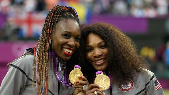 Gold medalists Serena Williams of the United States and Venus Williams of the United States celebrate during the medal ceremony for the Women's Doubles Tennis on Day 9 of the London 2012 Olympic Games at the All England Lawn Tennis and Croquet Club on August 5, 2012 in London, England. (Photo by Clive Brunskill/Getty Images)
