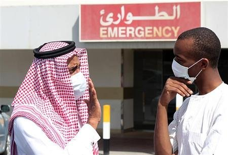 Men wearing surgical masks as a precautionary measure against the novel coronavirus, speak at a hospital in Khobar city in Dammam May 23, 2013. REUTERS/Stringer