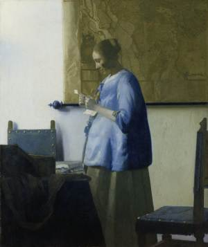 """This image released by the J. Paul Getty Museum shows the 17th century oil painting """"Woman in Blue Reading a Letter"""" by Johannes Vermeer. The painting will be on display at the J. Paul Getty Museum in Los Angeles for six weeks beginning Feb. 16. Only about three dozen paintings by the Dutch painter are known to exist, so the Getty exhibit is a rare opportunity for Vermeer fans to see one of his works. The painting is on loan from Amsterdam's Rijksmuseum.  (AP Photo/J. Paul Getty Museum)"""