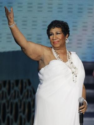 "FILE - In this May 17, 2011 file photo, singer Aretha Franklin appears at a taping of ""Surprise Oprah! A Farewell Spectacular,"" in Chicago. In a phone interview Wednesday night Jan. 4, 2012 from Atlanta, where her late father, Rev. C.L. Franklin, was to be honored by the Trumpet Awards for his achievements, a jovial Franklin says the proposal from her longtime friend, Willie Wilkerson was not entirely unexpected. (AP Photo/Charles Rex Arbogast, File)"