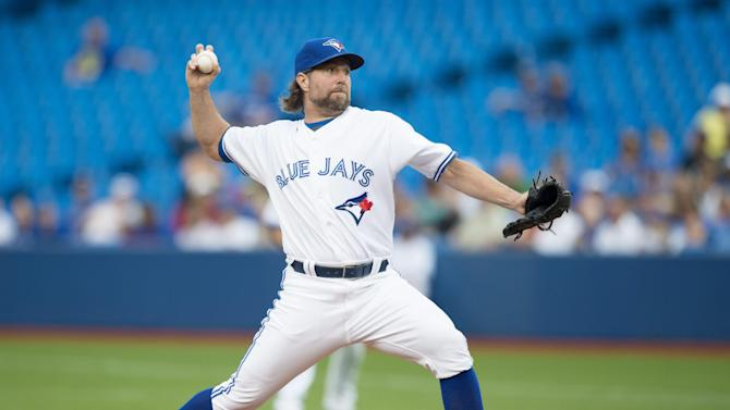 Toronto Blue Jays starting pitcher R.A. Dickey works against the Philadelphia Phillies during the first inning of their baseball game, Wednesday, July 29, 2015, in Toronto. (Darren Calabrese/The Canadian Press via AP) MANDATORY CREDIT