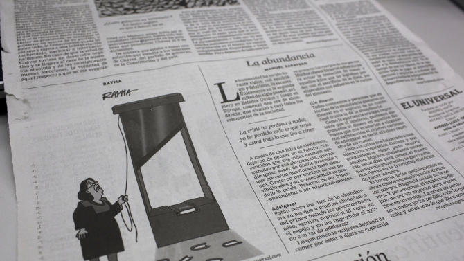 "A political cartoon published in the Thursday edition of the daily Venezuelan newspaper ""El Universal"" shows the Supreme Court chief cutting up the constitution, in Caracas, Venezuela, Friday, Jan. 11, 2013. A flurry of jokes and political cartoons have taken aim at the government's postponement of Chavez's inauguration. When the president's followers took to the streets to symbolically take the oath in Chavez's place, some critics said the outlandishness hit a new high. Venezuelan comedian Claudio Nazao says ""what's happening is so absurd that people don't know whether to laugh or cry."" (AP Photo/Ariana Cubillos)"