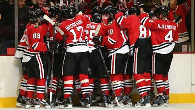 The Chicago Blackhawks celebrate a win over the Columbus Blue Jackets at the United Center (AFP)