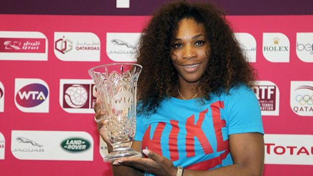 Serena Williams of the United States poses with a trophy given to her by the WTA Tour after the 31-year-old American reclaimed the world number one ranking following her WTA Qatar Open tennis quarter-final match against Czech Petra Kvitova (AFP)