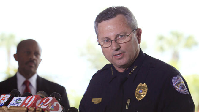 Sanford Police Chief Bill Lee speaks to the the media during a news conference Thursday, March 22, 2012 as city manager Norton Bonaparte Jr. listens at left, in Sanford Fla. Lee, who has been bitterly criticized for not arresting a neighborhood watch volunteer in the shooting death of an unarmed black teenager, announced that he is temporarily stepping down to let passions cool. (AP Photo/Julie Fletcher)