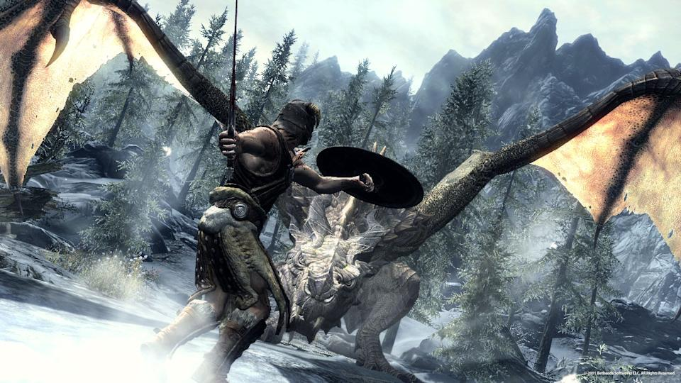 "In this video game image released by Bethesda Softworks, a Dragonborn hero battles one of the flying lizards in ""The Elder Scrolls V: Skyrim."" (AP Photo/Bethesda Softworks)"