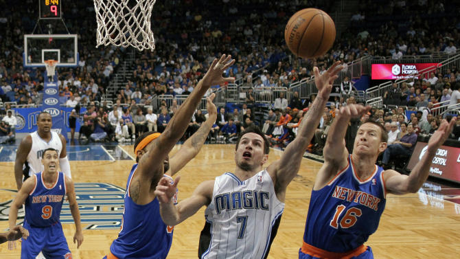Orlando Magic's J.J. Redick (7) goes up for a shot between New York Knicks' Steve Novak (16) and Rasheed Wallace, left, during the first half of an NBA basketball game, Tuesday, Nov. 13, 2012, in Orlando, Fla. (AP Photo/John Raoux)