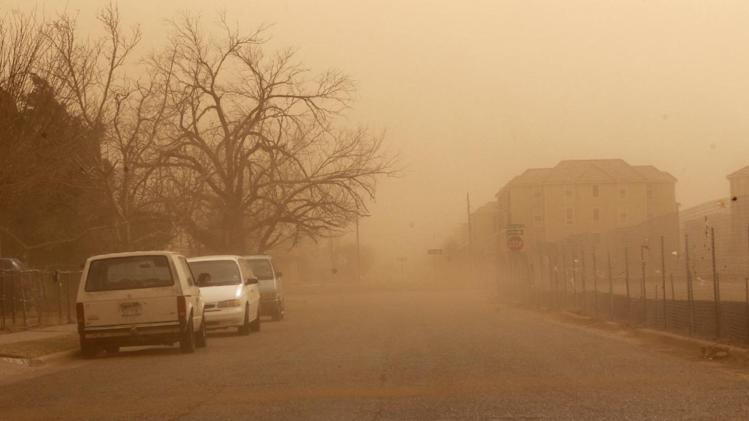 Dust covers a residential area during a dust storm in Lubbock, Texas, Wednesday, Dec. 19, 2012.(AP Photo/Lubbock Avalanche-Journal,Zach Long) ALL LOCAL TV OUT