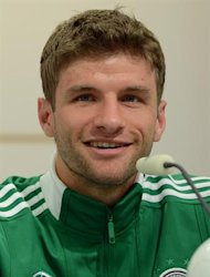 German forward Thomas Mueller speaks during a press conference at the media center near the Dwor Oliwski hotel in Gdansk on June 20, 2012, during the Euro 2012 football championships.      AFP PHOTO/ PATRIK STOLLARZ