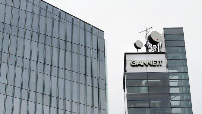 FILE - This July 14, 2010, file photo, shows Gannett headquarters in McLean, Va. Gannett is spinning off its publishing business from its broadcasting and digital operations. The company is also acquiring full ownership of Cars.com for $1.8 billion., the company announced Tuesday, Aug. 5, 2014. (AP Photo/Jacquelyn Martin, File)