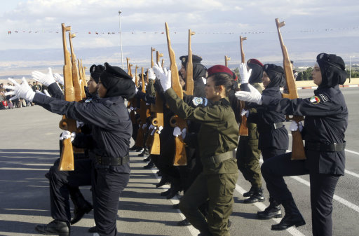 Palestinian female security forces loyal to Palestinian President Mahmoud Abbas march with mock wooden rifles during a graduation ceremony in the West Bank city of Jericho, Thursday, Jan. 19, 2012.(AP Photo/Mohammed Ballas)