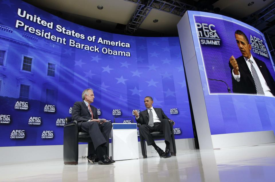 President Barack Obama answers questions at the APEC CEO Summit with Boeing Chief Executive Officer Jim McNerney in Honolulu, Hawaii on Saturday, Nov. 12, 2011. (AP Photo/Charles Dharapak)
