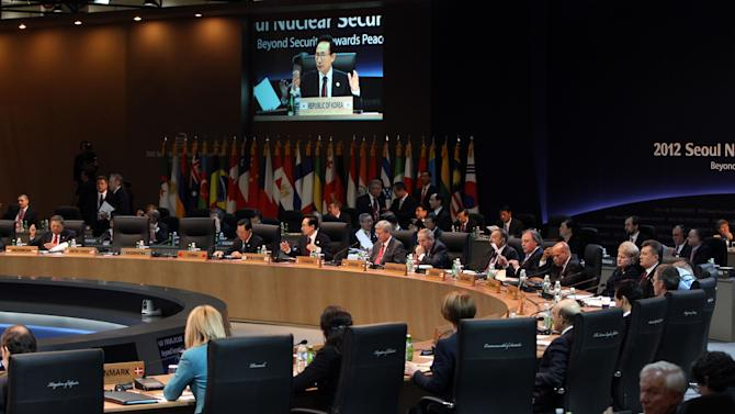 South Korean President Lee Myung-bak, third from left in back, speaks during the second plenary session of the Nuclear Security Summit at the Coex Center in Seoul, South Korea, Tuesday, March, 27, 2012. (AP Photo/Yonhap) KOREA OUT